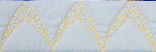 arch border with wishbone filler, quilted by Angela Huffman