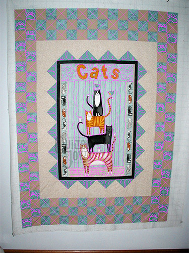 Gail's Cats Panel Quilt, with machine quilting ideas by Angela Huffman