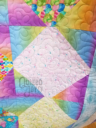 April's Easter quilt after quilting it at Quilted Joy