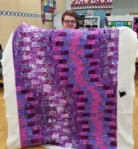 Dustin's purple quilt after quilting it at Quilted Joy