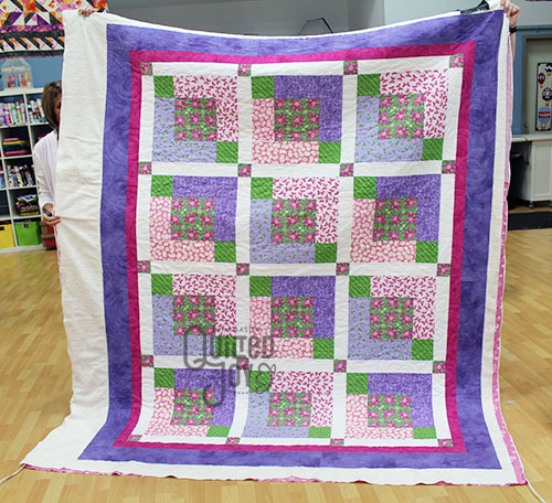 Nancy's Purple Flowers Quilt after quilting it at Quilted Joy