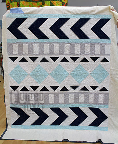 Valerie quilted this grey and blue graphical quilt at Quilted Joy