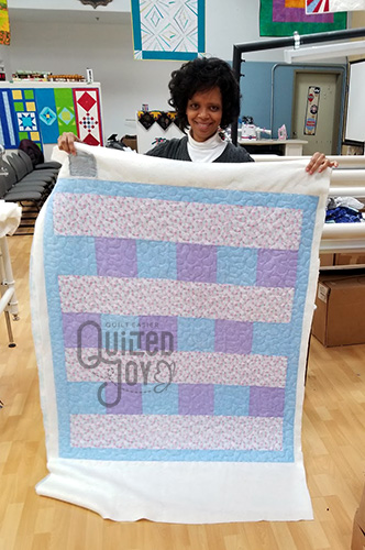 Yolanda's quilt after quilting it at Quilted Joy