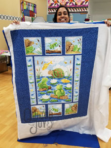 Anu's Suzybee Panel Quilt after quilting it at Quilted Joy